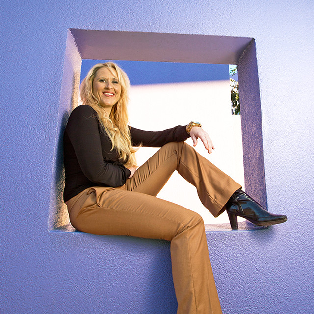 Sheri Atwood sitting on a ledge